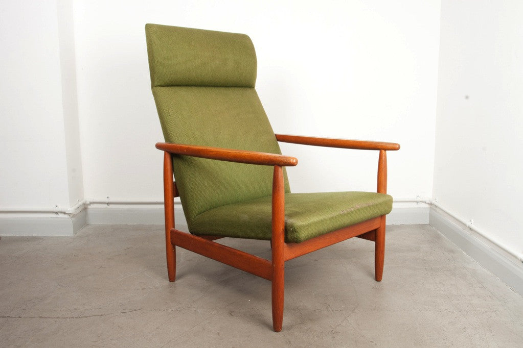High back lounge chair by Ejvind A. Johansson