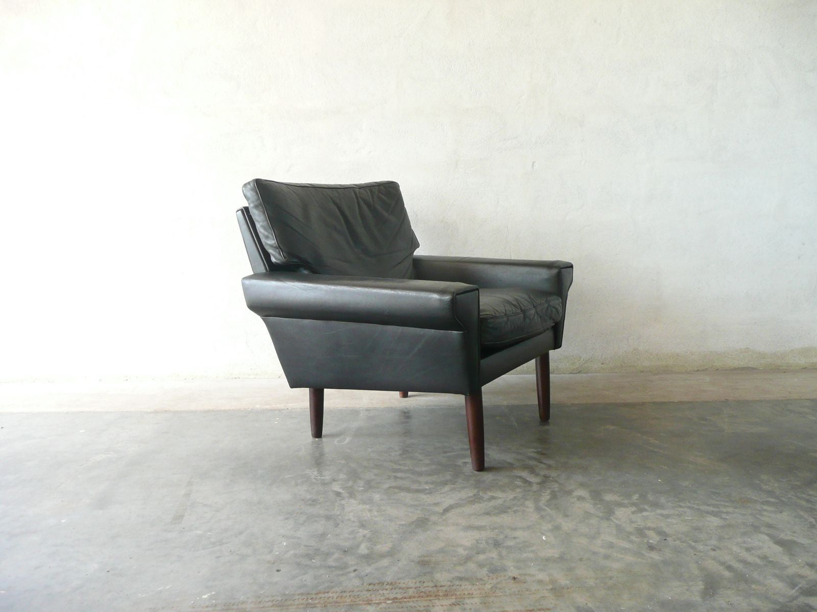 Lowback black leather lounge chair