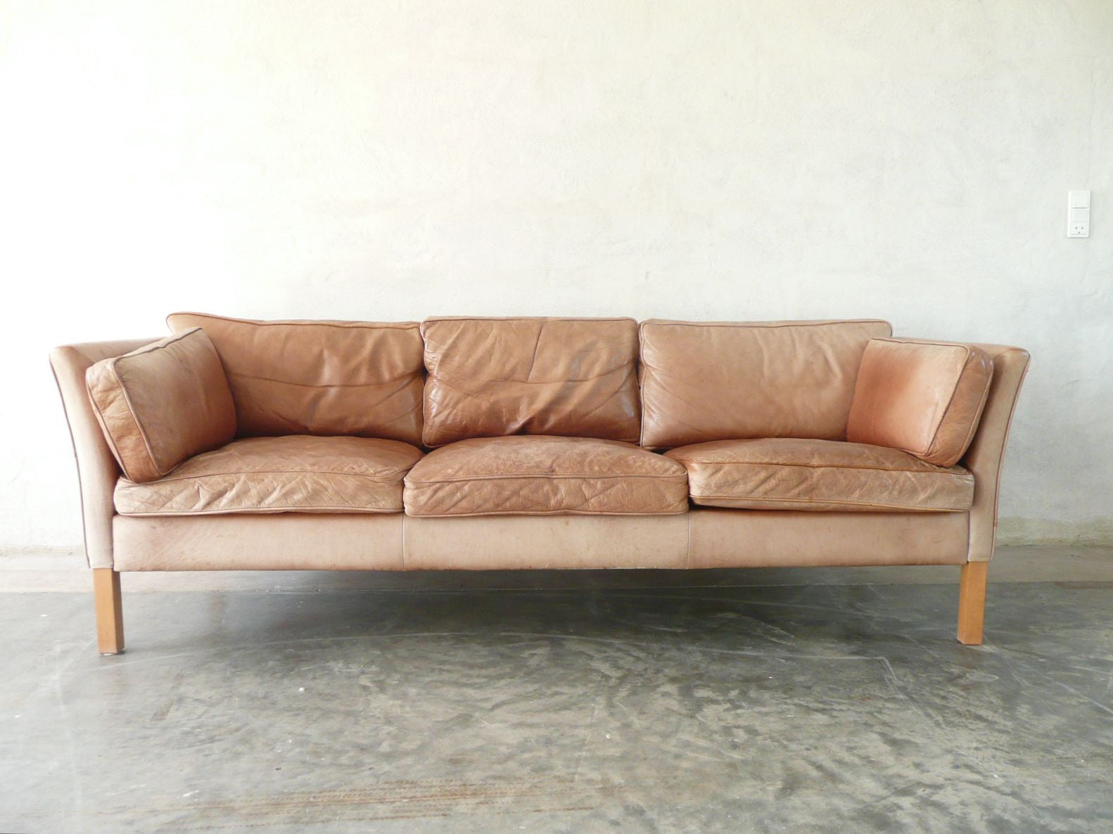 Tanned leather three seat sofa