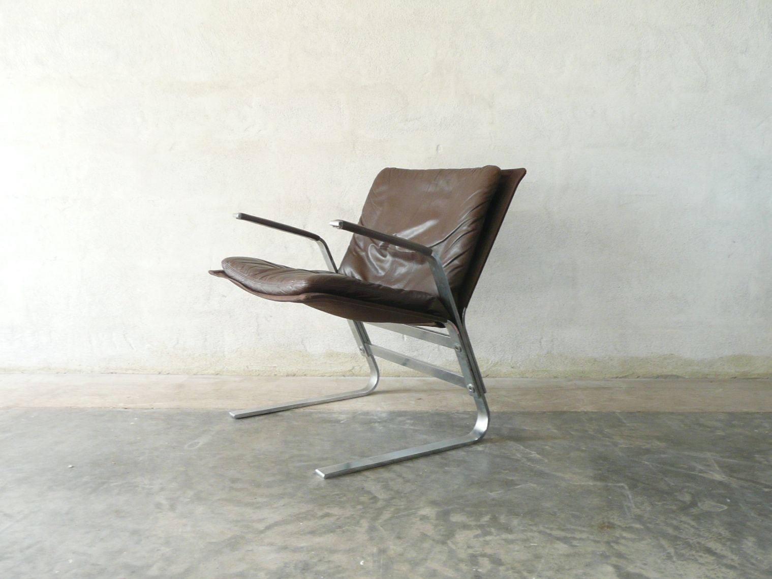 Chromed steel and leather occasional chair