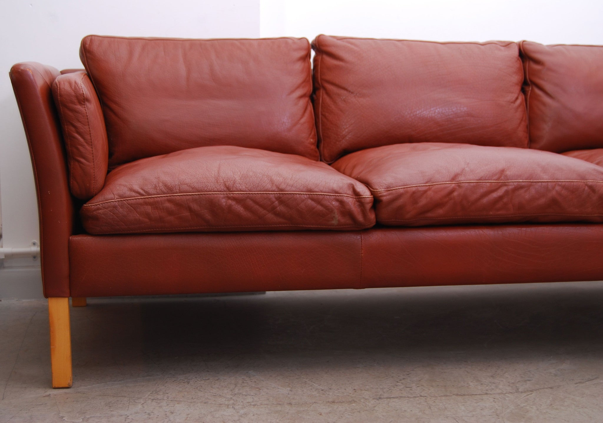 Three seat leather sofa by Stouby