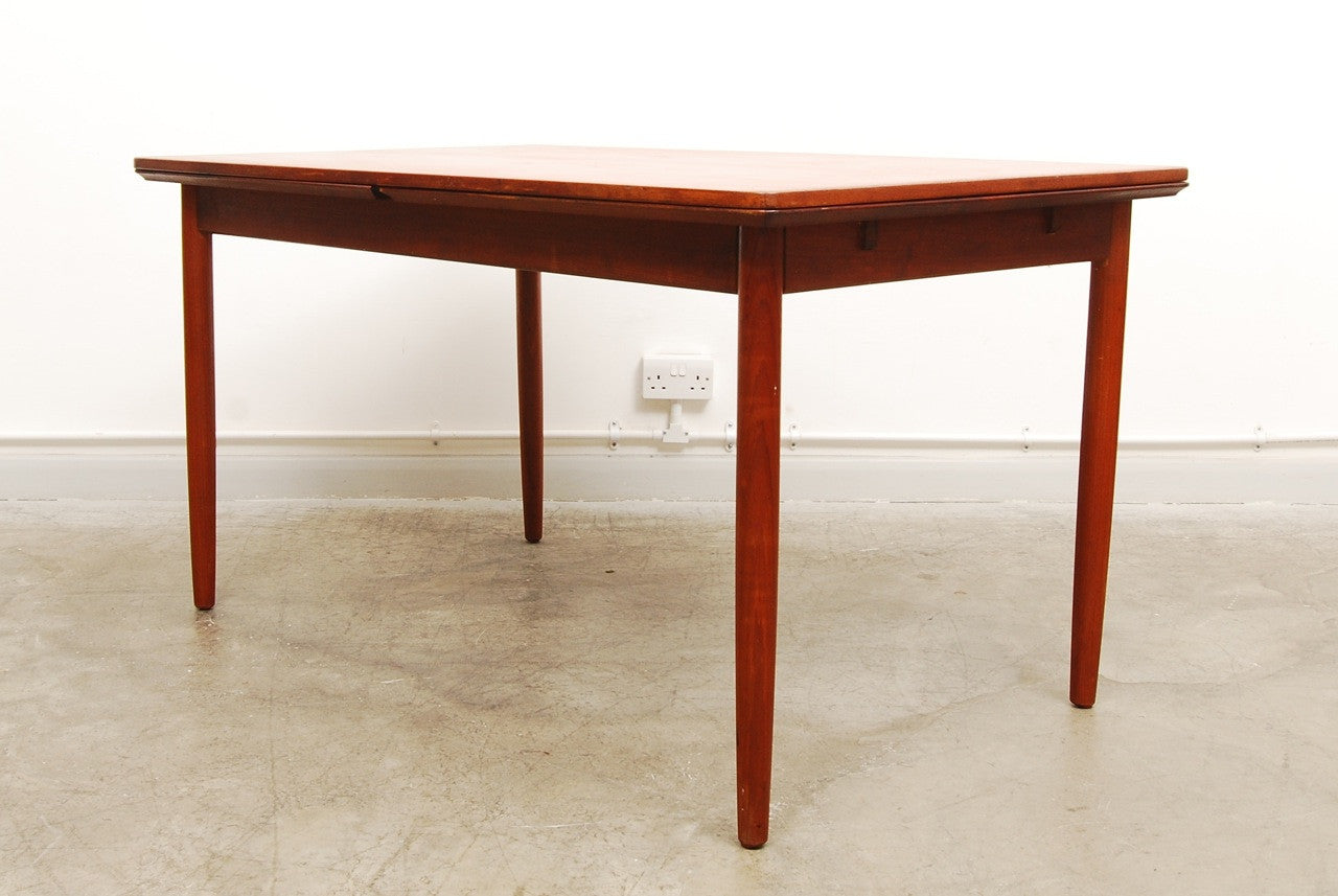 Large extending dining table in teak