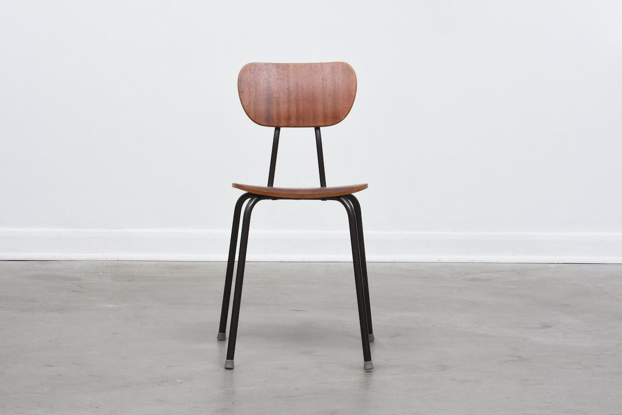 One left: Teak + metal stacking chairs