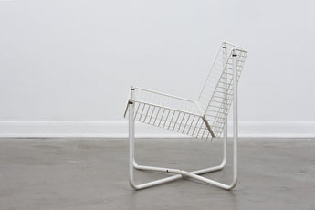 One left: 'Jarpen' lounge chairs by Niels Gammelgard