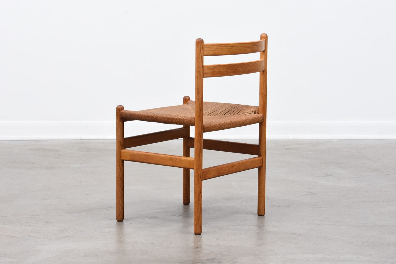 Two available: Oiled oak + cord chairs by Kurt Østervig
