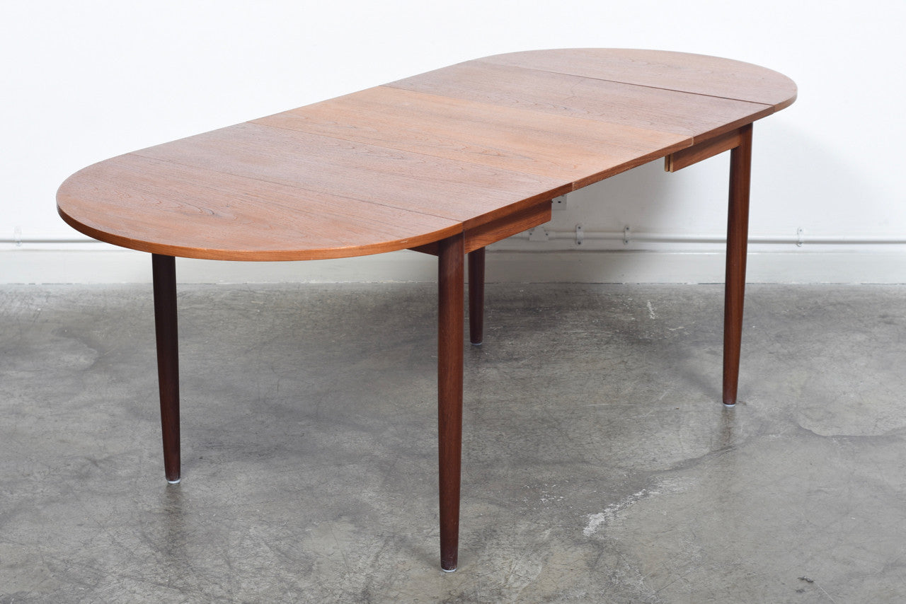 Extending square dining table in teak