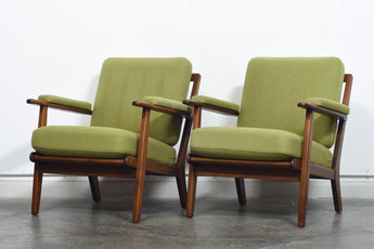 Two available: 1950s loungers with grass green wool cushions