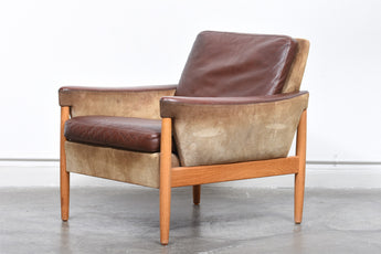 Two available: Suede, leather + oak loungers by Kurt Østervig