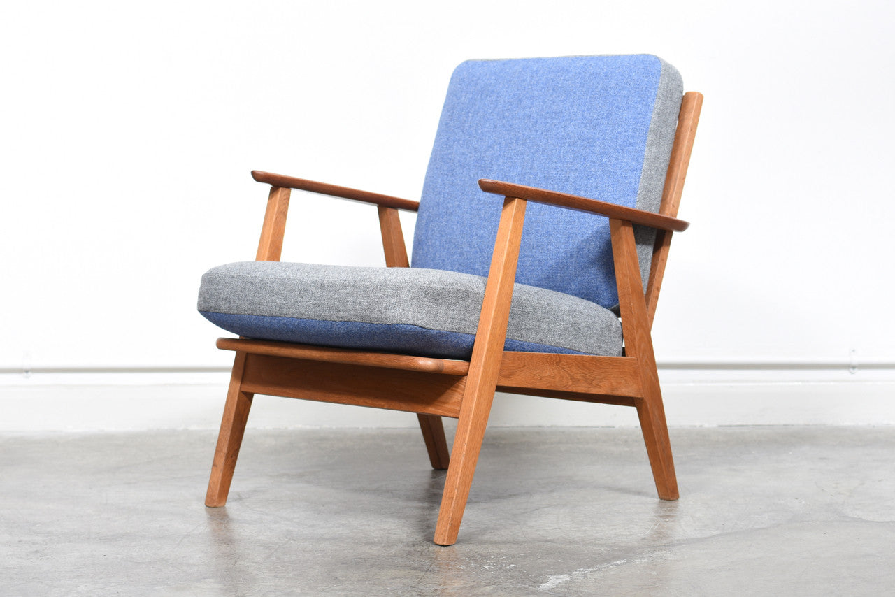 Teak and oak lounge chair with reversible cushions