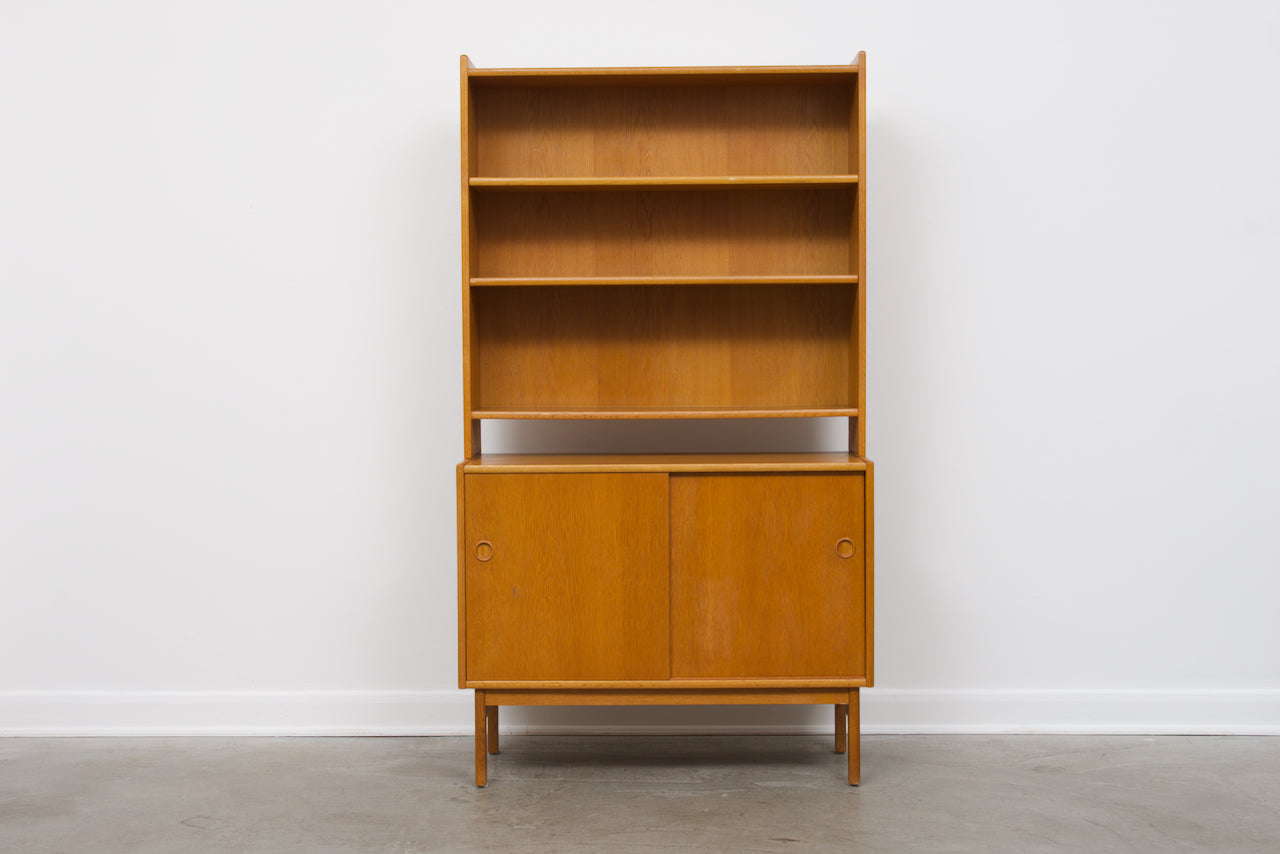 1960s Danish oak storage cabinet with bookshelf