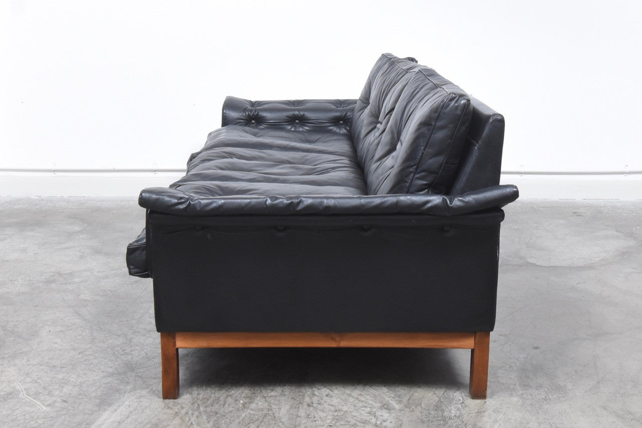 Not specified Black leather three seat sofa