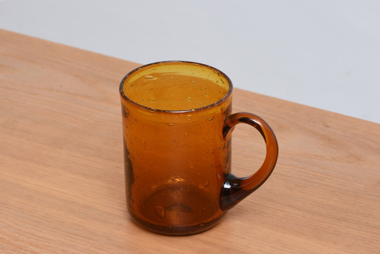Amber glass mug by Erik Hoglund