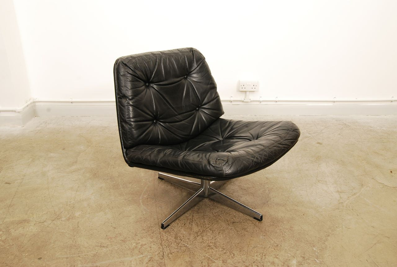 Low leather lounger on swivel base