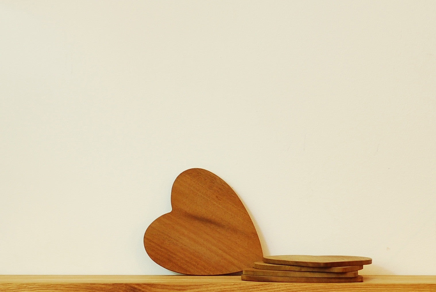 Heart shaped teak coasters