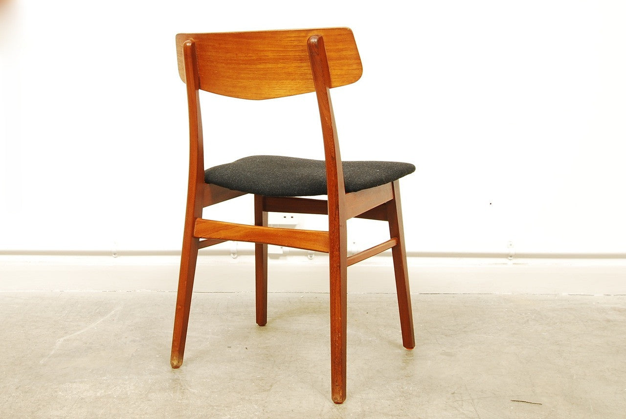 Set of four teak dining chairs with new black upholstery