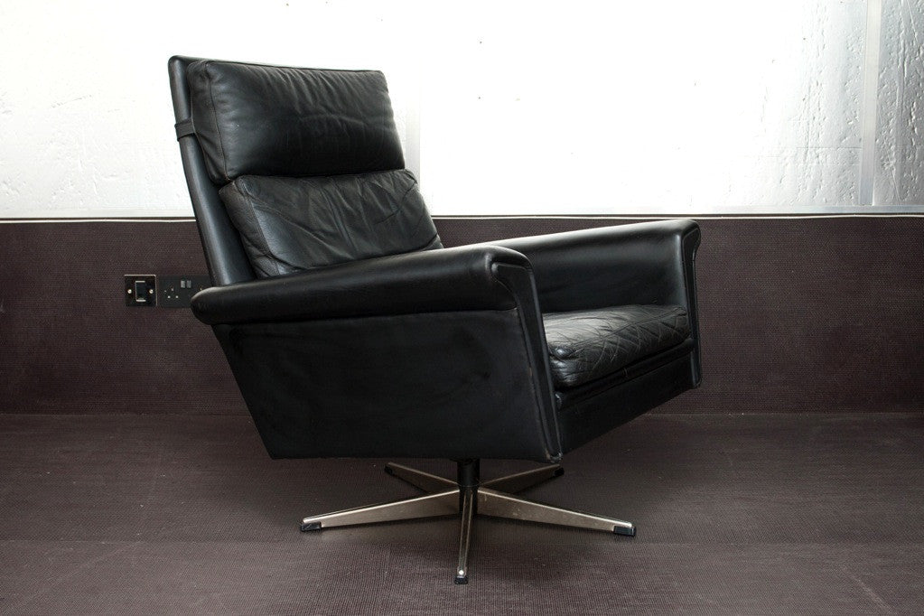 High back leather lounger on chrome swivel base