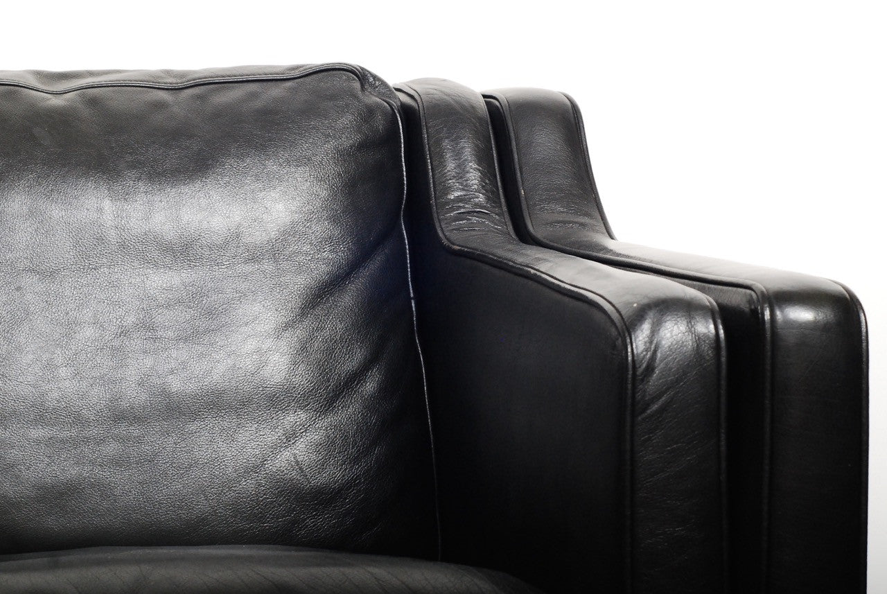 Two seat black leather sofa