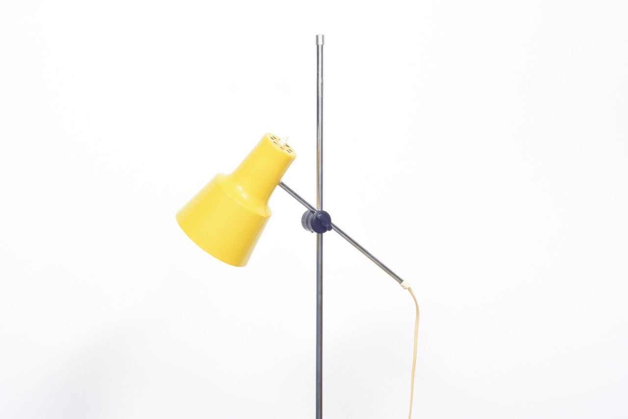 Floor lamp with yellow shade