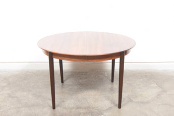 Extending rosewood dining table by Skovby