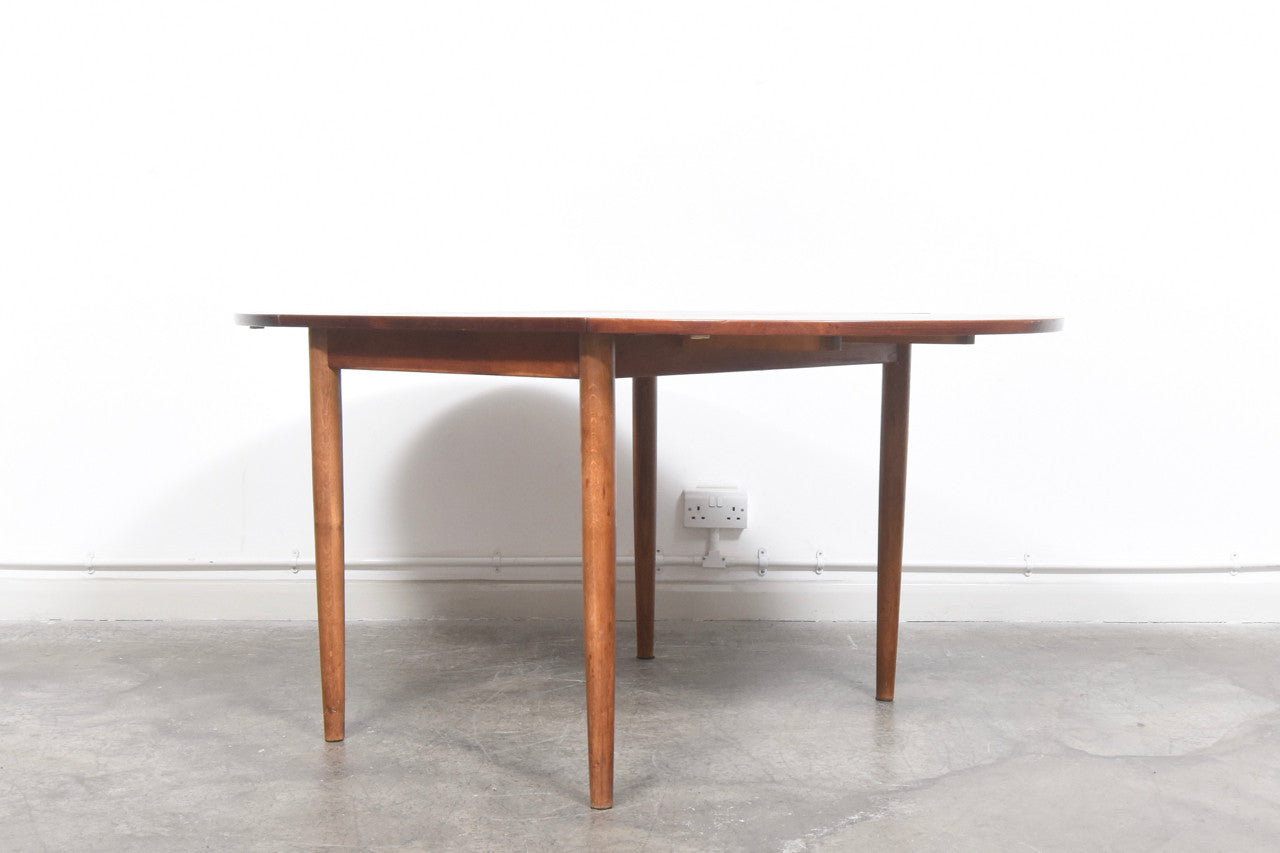 Narrow teak dining table with drop leaves