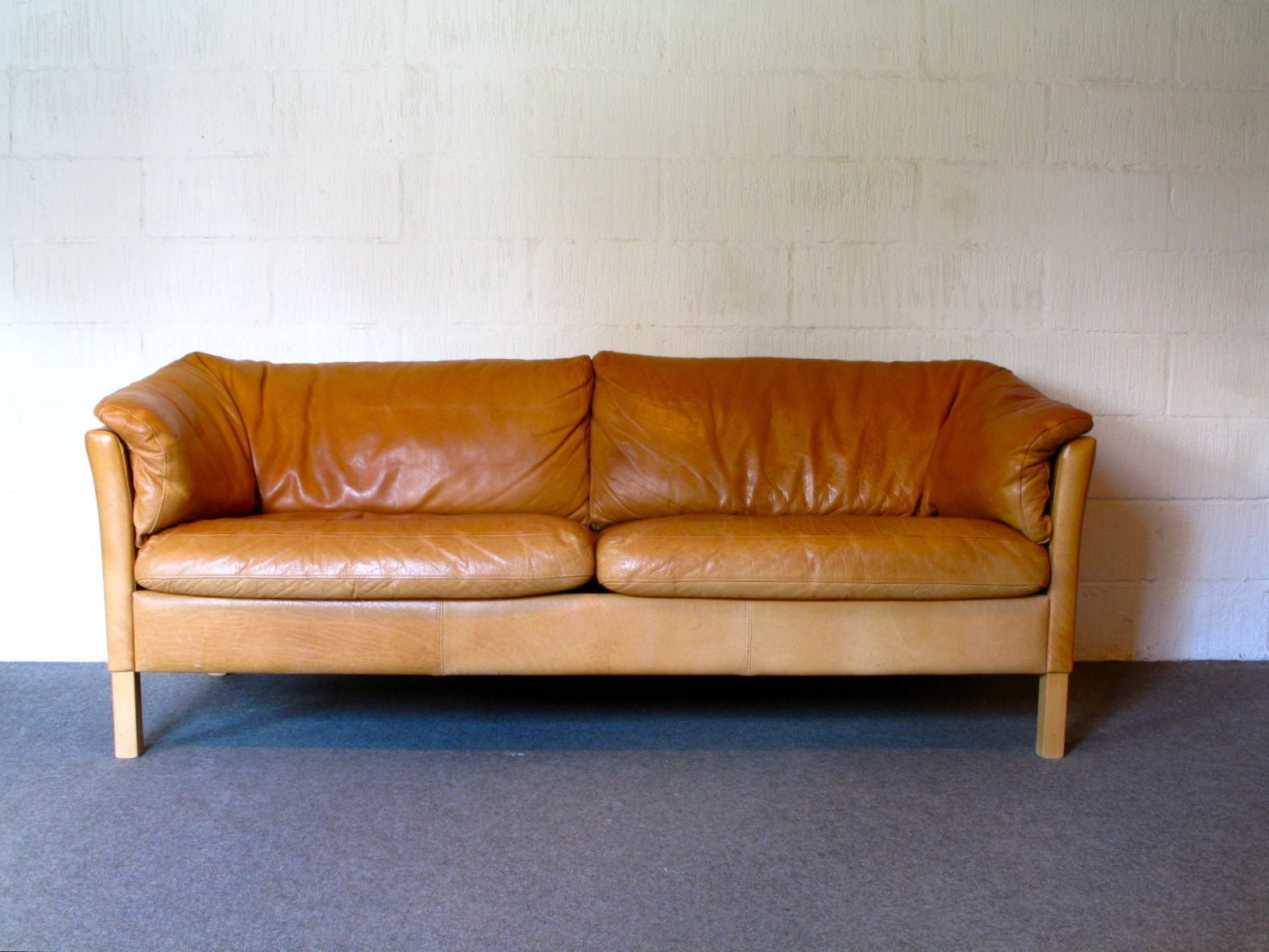 Two and a half seat leather sofa by Mogens Hansen