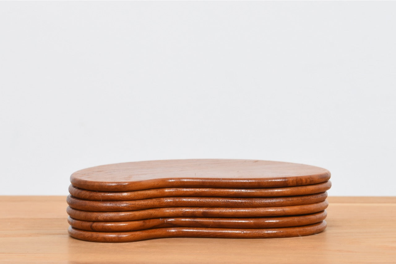 Set of six teak coasters