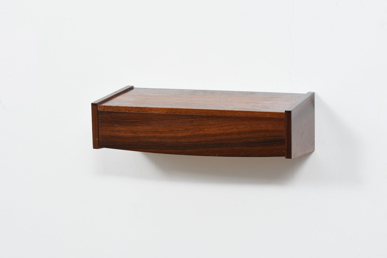 Floating drawer in rosewood