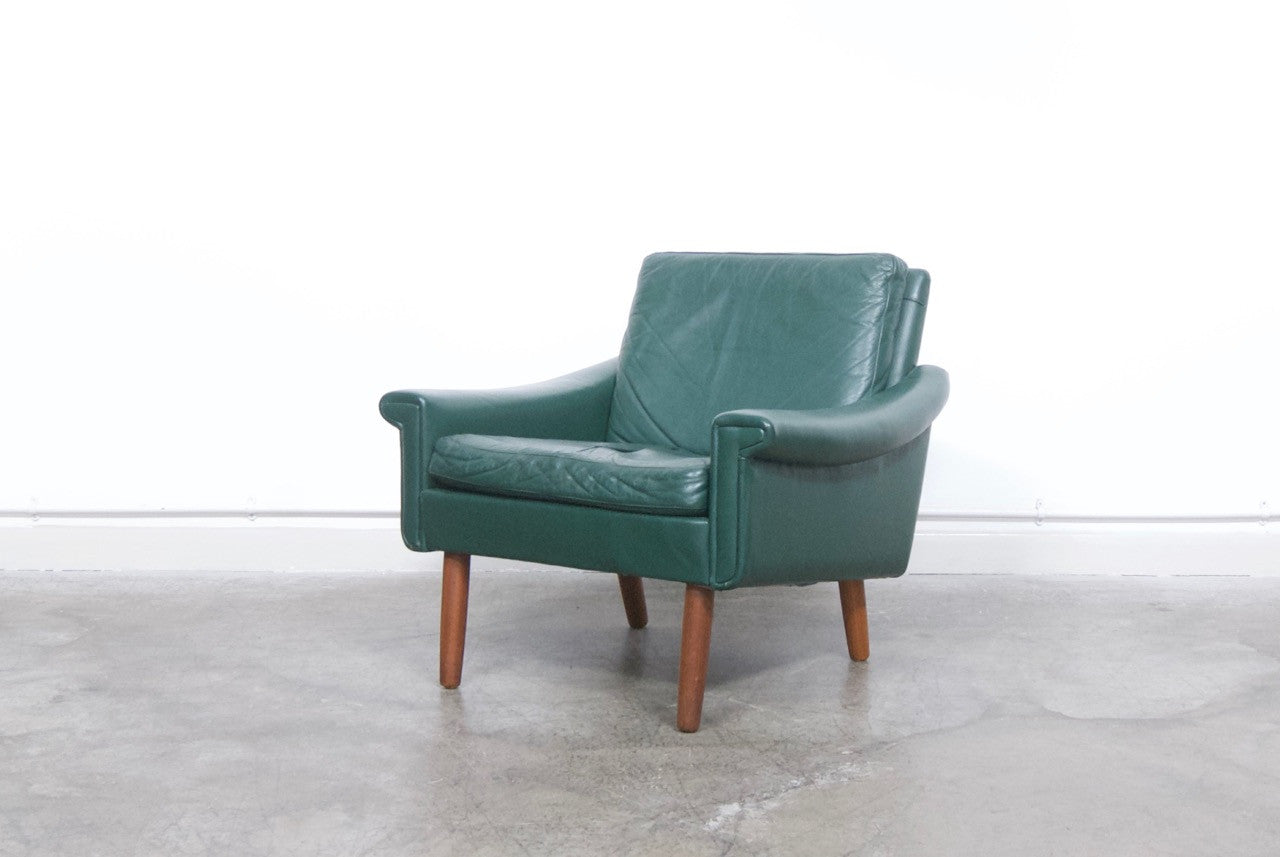 Low back green leather lounge chair