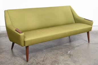1960s Danish sofa on turned teak legs