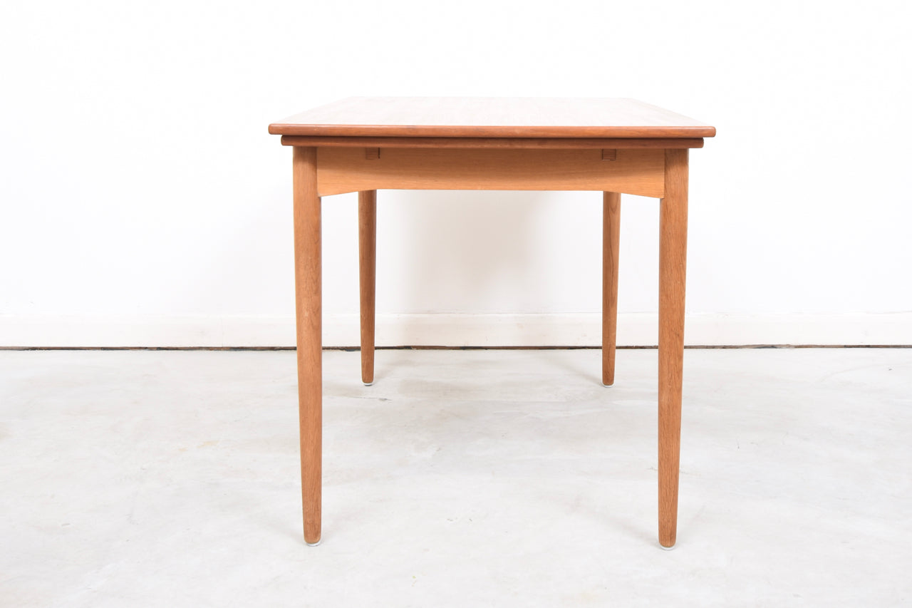 Extending teak dining table with oak base