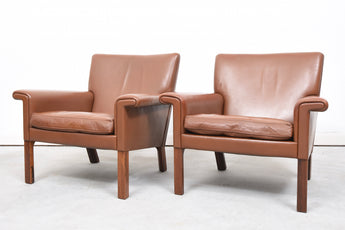 Two available: Leather lounge chair by G. Thams
