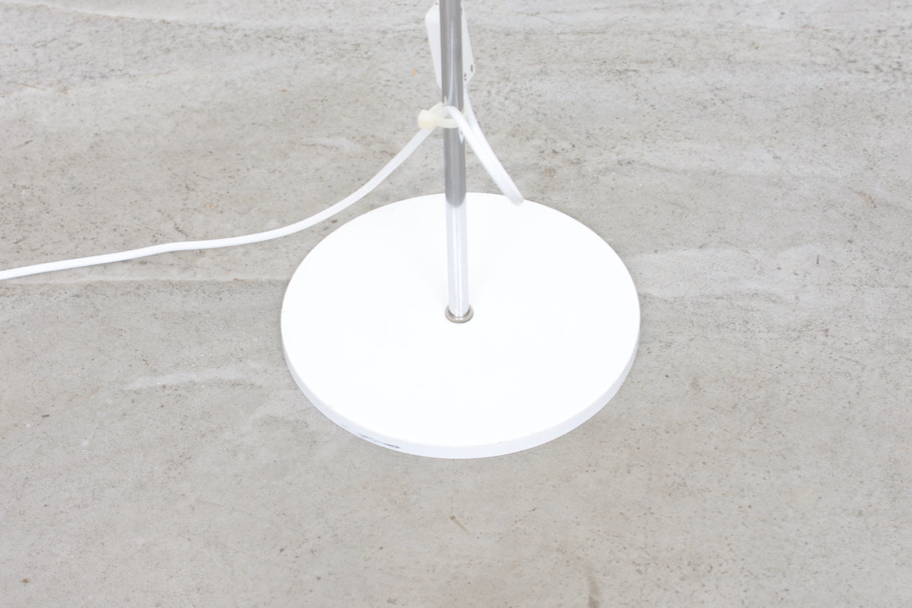 Twin-headed floor lamp with white shades