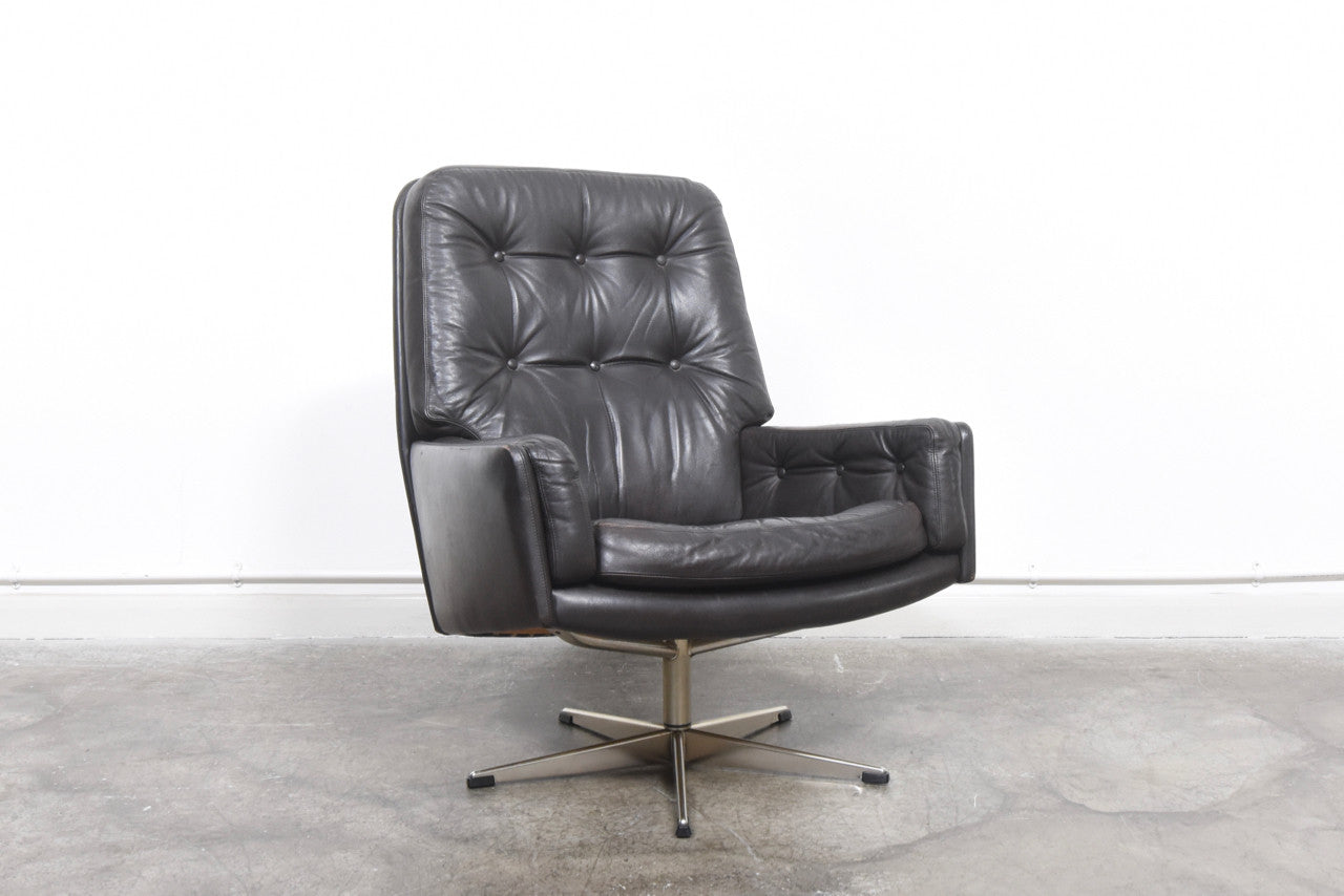 PrebenJan16 Dark brown leather lounge chair on swivel base