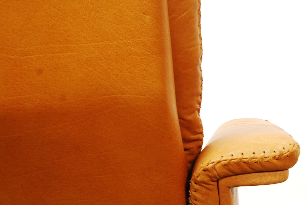 Tan leather lounger on swivel base