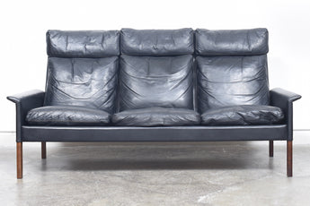 High back three seat leather sofa by Hans Olsen