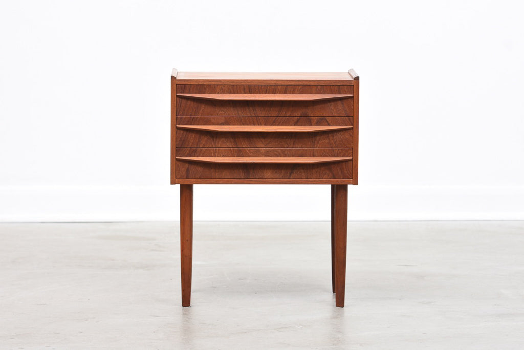 Low teak chest of three drawers