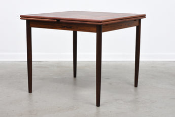 Extending rosewood dining table