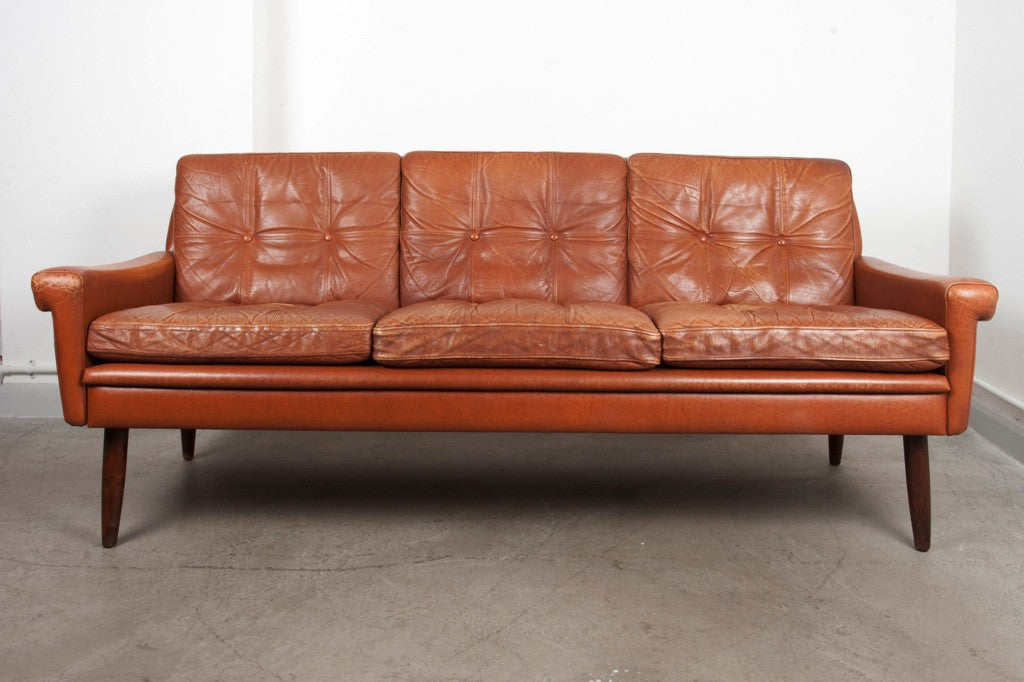 Three seat tan leather sofa by Skipper