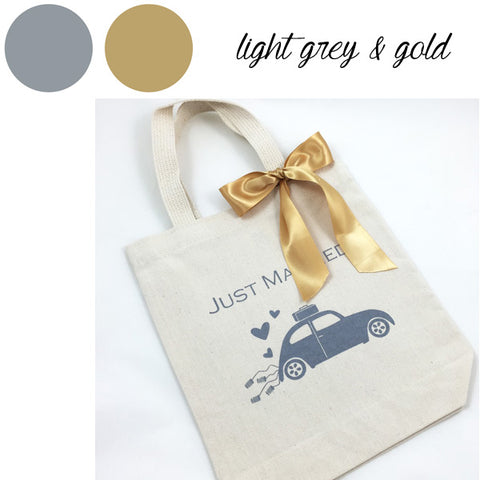 light grey and gold hotel welcome bags
