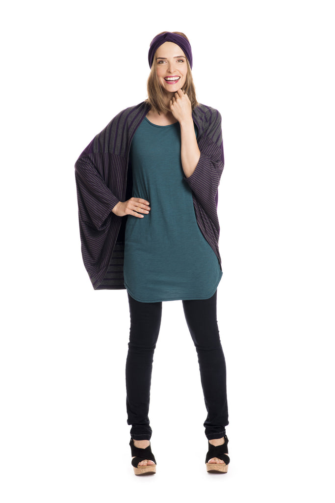 Teal tunic with purple and grey striped cardigan.