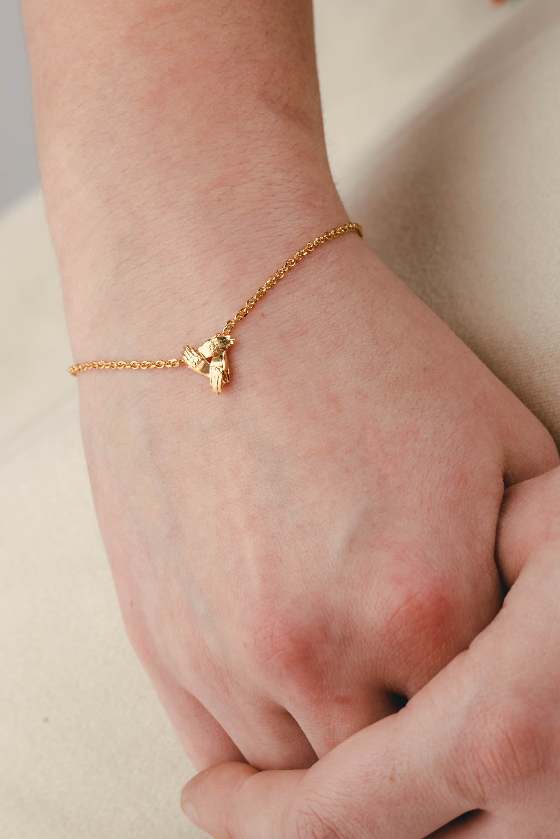 Three Supporting Hands Bracelet