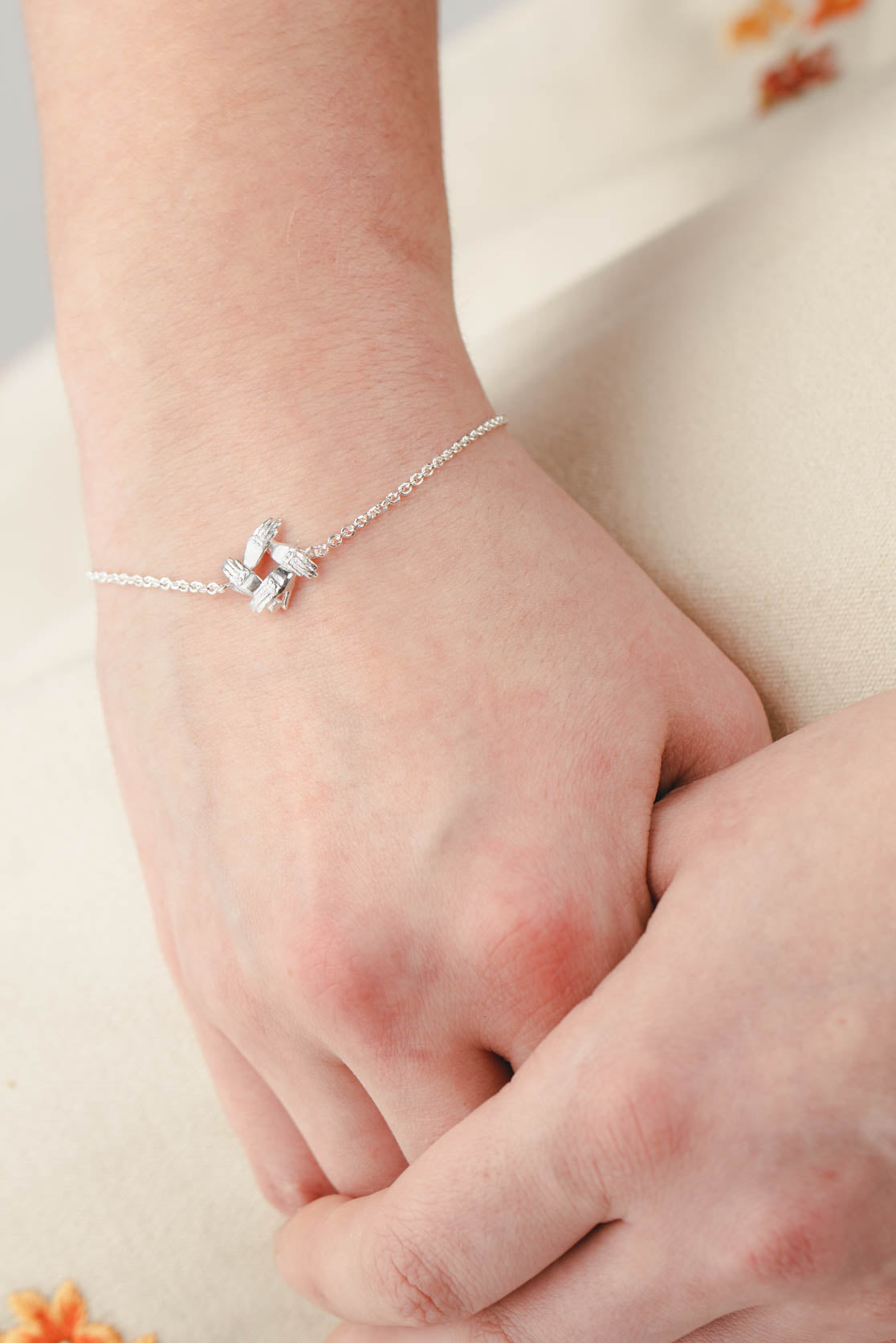 Four Supporting Hands Bracelet