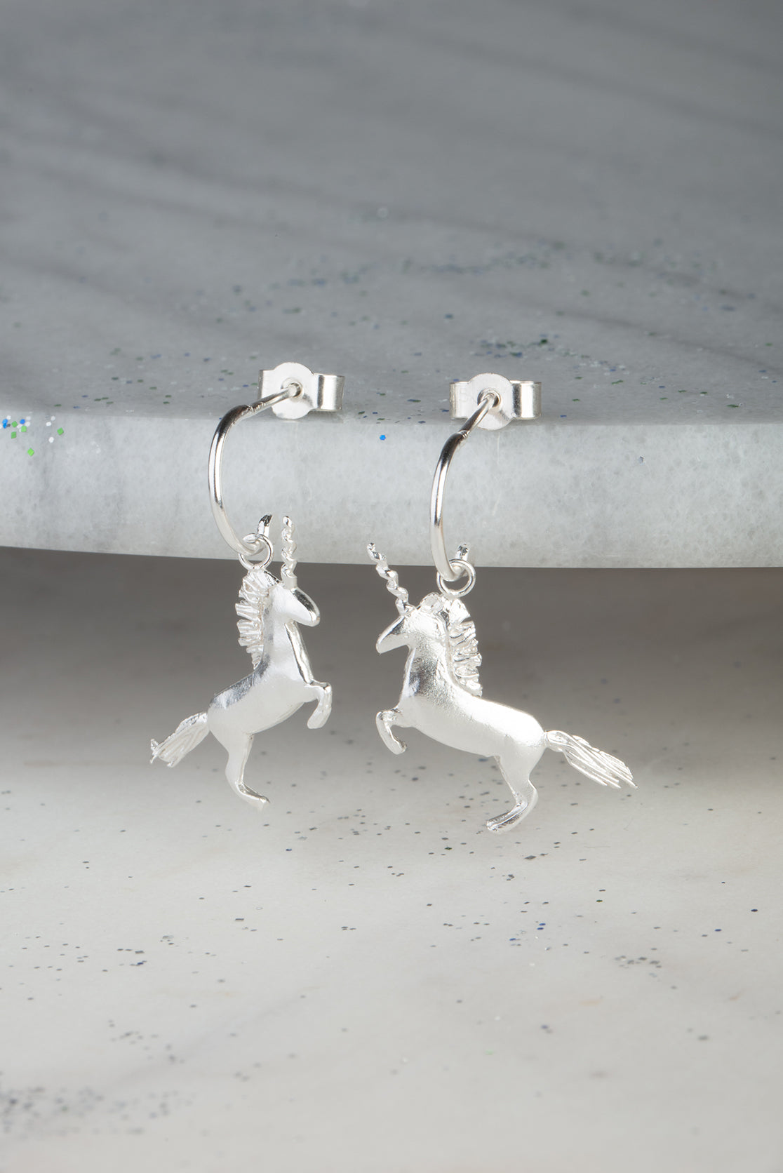 unicorn earrings on half hoops