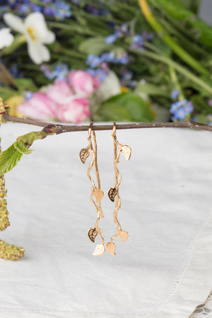 long vine leaf earrings in 22ct gold plate