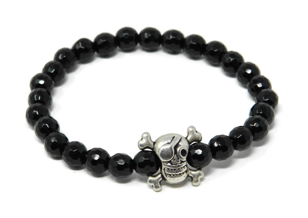 Elastic bracelet with black onyx balls and skull