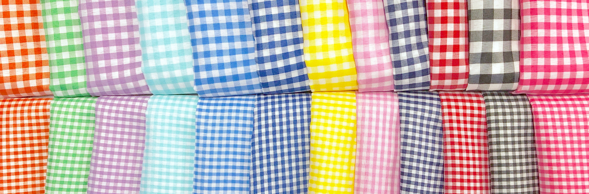 A rainbow assortment of gingham print fabric.