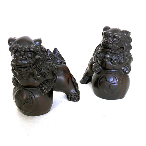 Pair of Fu Dogs with yin and yang symbol, cast resin, Chinese, 20th century