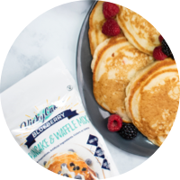 plate of pancakes and bag of blueberry pancake mix