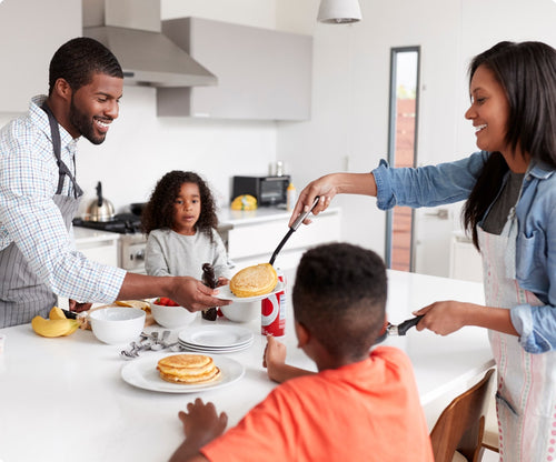 family in the kitchen making pancakes