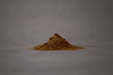 Pile of Holy Basil powder supplement by Respect des Fonds, or RDF